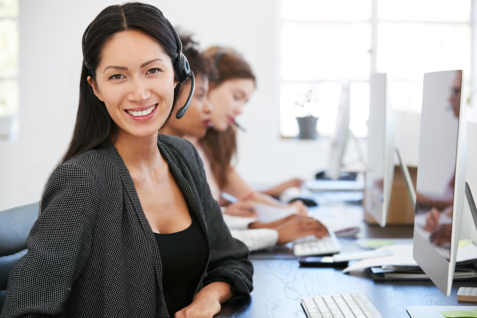 young-asian-woman-with-headset-smiling-to-camera-PL8ZF9M.jpg